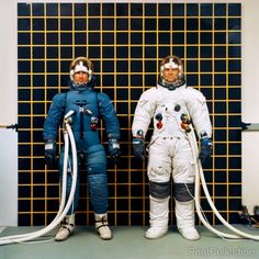 Astronauts Irwin and Bull modeling the Apollo IVA (Intravehicular Activity) and (EVA) Extravehicular Activity spacesuits.