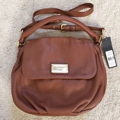NWT- Marc Jacobs Classic Q Lil Ukita New and never used.                                                  The color is Cinnamon Stick (cognac)                     Buttery soft leather!!                                               Measurements: Bottom Width: 12 in Depth: 4 in Height: 11 1/2 in Handle Drop: 5 in Strap Length: 42 in Strap Drop: 20 in **Pet- Free and Smoke-Free home** Marc by Marc Jacobs Bags