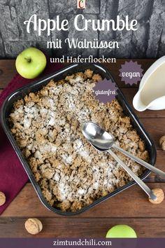 APPLE CRUMBLE MIT WALNÜSSEN UND HAFERFLOCKENWas gibt es schöneres als einen warmen Apple Crumble mit knusprigen Streuseln zum Dessert? Genau! Einen warmen Apple Crumble mit Walnüssen, knusprigen Streuseln und Vanilleeis. Das Rezept ist vegan und glutenfrei. Die Nachspeise mit Äpfeln passt in den Herbst. #AppleCrumblemitWalnüssen #AppleCrumbleRezept #ApfelkuchenRezept #CrumbleRezept #StreuselkuchenRezept #AppleCrumblemitHaferflocken #DessertRezept #Dessertvegan #NachspeiseRezept #KuchenRezept