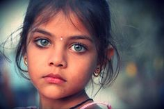 The Eyes of Children around the World India © Cynthia Fayman This photo was taken on the Indian Pakistan border last September. This Indian beauty was on her father's shoulder looking back at me at the time of the photograph. We had just witnessed the closing ceremony at the border which has happened every day for the last 53 years.