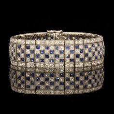 ART DECO SAPPHIRE & DIAMOND BRACELET Articulated strap millegrain set with a chequer board pattern of French cut sapphires & single cut diamonds. £22,500.00