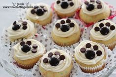 Junior Mints and chocolate chips (bottom side up) are a fast, easy & cute way to make #PawPrintCupcakes.