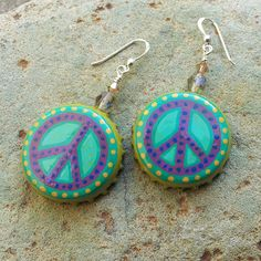 Hand-painted bottle cap earrings with peace signs