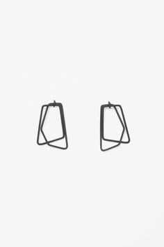 Designed with interlocking square-shaped pendants, these earrings are designed for pierced ears.
