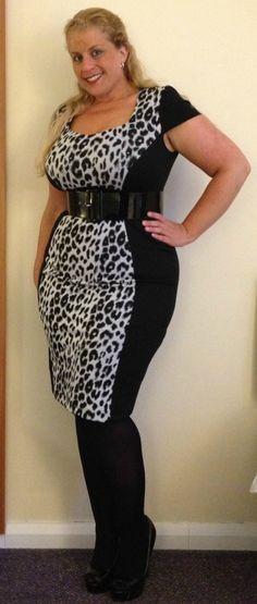 Curvy Woman Black and White Animal Print Dress Wide Black Belt Black Tights and Black High Heels
