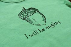 mighty acorn onesie - and I'd get a matching kids' tee for E ($24.00 thecoinlaundry.etsy.com)