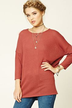 A purl knit top featuring a boxy silhouette, 3/4 sleeves, and a round neckline.
