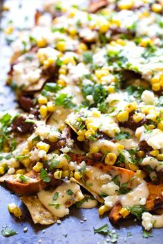 Healthy Grilled Sweet Potato Nachos - roasted corn, black beans, grilled sweet potatoes, multigrain chips, and a lightened up homemade chees...