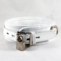 """These high quality hand crafted restraint Collar ensure that you or your partner are under control!!!. These premium restraints collar is 2 inches wide and reinforced with three layers of leather.     Features:  1) Ideal to control and restraint!!!  2) All studs are covered by leather to protect your skin/body.  3) Premium D rings and fittings.  4) Use a padlock for extra security. (YOU GET ONE FREE PADLOCK)  5) Measures approx. S/M size 52 cm"""" / 20.5', M/L size 58 cm"""" / 23', and size XL…"""