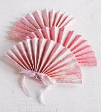 DIY paper fan for a summer wedding...all you need is ribbon, scrapbook paper, hole punch, patterned-edge scissors