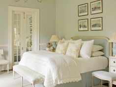 This bed! Creams and whites, textured, squishy. Love the narrow bench at the base, and the simple framed images.