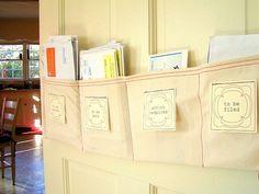 DIY Mail Sorter (apply idea to hang above/below each child's coat hanger for school folders)