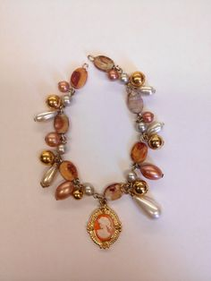 Cameo Charm Bracelet design from Upcycled Vintage Jewelry by Janice Downs. Visit www.facebook.com/upcycledvintagejewelry