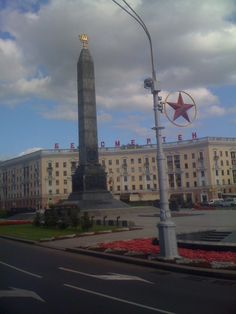 Belarus suffered heavily from Nazi occupation during WWII. 25% of its people died during the war and hundreds of villages were decimated. Minsk was a major center of the resistance movement. For this, Minsk was awarded the title Hero City in 1974. The Monument consists of the column with heroic scenes, an eternal flame, and granite blocks for each Soviet hero city. There is a passage below the memorial with an illuminated wreath of colored glass and plaques with the names of 566 soldiers.