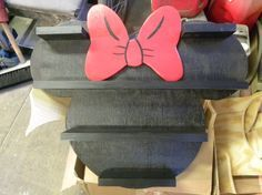 Minnie Mouse Vinylmation or Infinity Shelf.