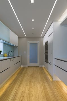 LED Soft Strip provides beautiful under-cabinet lighting for this ultra-modern kitchen | LED lighting for kitchens and dining rooms | Soft Strip - by Edge Lighting