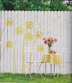 A Dandelion stenciled white fence spotted in DIY Outdoor Living Magazine. http://www.cuttingedgestencils.com/dandelion-stencil.html