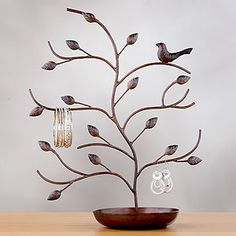 Yes, like Portlandia says, put a bird on it! It's a functional, artsy jewelry tree.