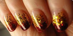 gold & red sparkle nails, perhaps a great choice for a hunger games look