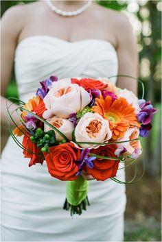 Orange and Pink Wedding Gergera and roses with peony and loops of bere grass