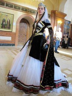 Woman in traditional Georgian dress in Sameba