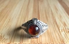 Amber poison ring available at both our North and South Calgary locations.