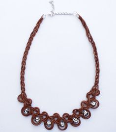 With this Elegant and Earthy Knotted Necklace, you get the best of both worlds. By using a brown leather cord, you give this DIY necklace a rustic and natural feel, and with the shinning silver beads, this DIY jewelry piece becomes an elegant and stunning necklace.