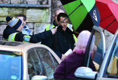 SHERLOCK (BBC) ~ Benedict Cumberbatch (Sherlock) leaving a set on January 6, 2015 during the first day of filming the pre-Season 4 special. Martin Freeman (John) is in the car's front seat.