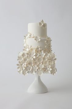 Beautiful Cake Pictures: Little White Flower Garden Wedding Cake Picture - Flower Cake, Wedding Cakes, White Cakes - Fondant Wedding Cakes, Floral Wedding Cakes, White Wedding Cakes, Beautiful Wedding Cakes, Gorgeous Cakes, Wedding Cake Designs, Pretty Cakes, Fondant Cakes, Cupcake Cakes