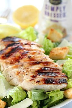 Grilled Chicken Caesar Salad for a yummy summertime lunch or dinner! With a simple yogurt marinade recipe, this grilled chicken is tender and delicious. Served over romaine lettuce, homemade croutons, shaved parmesan and caesar dressing - YUM! Easy Salad Recipes, Healthy Chicken Recipes, Beef Recipes, Grill Recipes, Healthy Appetizers, Easy Healthy Dinners, Healthy Snacks, Grilled Chicken Ceasar Salad, Chicken Salad