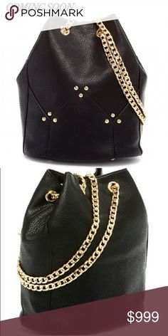 """Black Bucket  Bag Black featuring an ever-trending bucket shape and eye catching link chain shoulder strap, this standout bag finishes your look in bold style.  ~Dual adjustable chain shoulder straps ~Drawstring closure ~Exterior features gold-tone hardware ~Approx 9.75"""" H x 6.5"""" W x 6.75"""" D ~Approx 12"""" handle drop, 12-25"""" strap drop ~PU exterior, fabric lining.  🚫Trades Pink Haley Bags Crossbody Bags"""