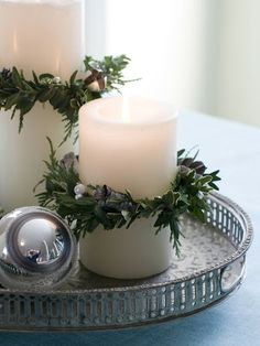Christmas Delight! - Magnolia Homes :: These rings may be hard to find, use cedar branches instead and just tie a knot with the natural greenery around the candle.