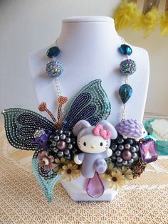 Look at this amazing necklace made by Floralba Gomez using Jesse James Beads and a vintage Hello Kitty piece. Amazing!