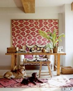 I love the framed patterned fabric on this wall (as seen in Elle Decor magazine and featured on Lauren Casey Interiors). Paired with patterned pillows and a rug=fabulous!