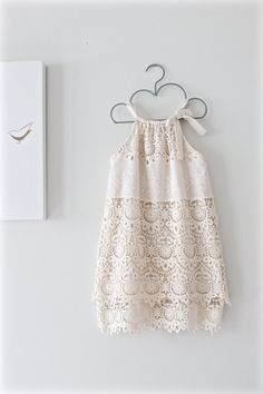 This dress is so pretty! It is made in beautiful cream Battenburg cotton lace which is fully lined in the matching embroidered fabric. This is an