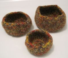 My latest bowls - these are made with two strands of an orange variegated wool yarn plus a thicker dark heather. The more strands - the heavier the bowls!