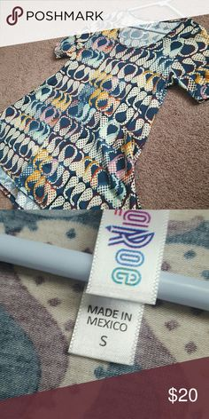 LuLaRoe Perfect Tee - Small Excellent used condition! Spring cleaning and I don't love this as much as I used to. Always washed in cold water on delicate cycle and hung to dry. No pilling, holes, other flaws. Very well taken care of. LuLaRoe Tops