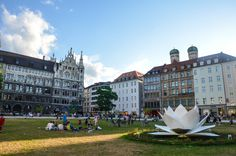 Enjoy a sunny afternoon in the middle of munches city center. Admiring the beauty of the sculpture in form of a giant open lotus flower of the artist Hyon-Soo Kim. It shapes the green area behind the town hall until 09/13/15.