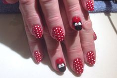 #1. Minnie: Acrylic nails with red polish, white polka dots and Minnie Mouse nail art accents. (Royal Nails, Gun Barrel City, TX)