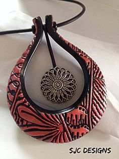 "Beautiful pendant by Samantha Cahoon.  The Design is inspired by my ""Shape"" ebook and she used my Conga Line texture stamp - Love it!"