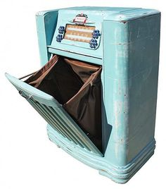 This vintage Philco AM Radio & Turntable was repurposed into a stylish clothes hamper.
