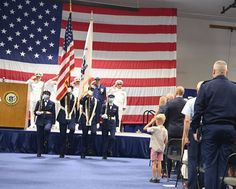 The official party, guests, and family members stand at attention during the national anthem at a change of command at Coast Guard Base Seattle. Coast Guard Bases, Patriotic Poems, Standing At Attention, National Anthem, American Pride, United States, Change, Party Guests, Seattle