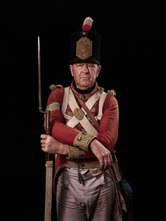 Ross Watson, corporal, 44th (East Essex) Regiment of Foot  Watson, 57, from Reading, joined a re-enactment society 10 years ago. 'I watched an event with my son, who was 13 at the time and wanted to take part,' he remembers. 'He hated it, but I loved it and stayed.' Watson's wife also participates as a camp follower. 'She's one of the best wood-campfire cooks around,' says Watson, who also acts as something of a handyman. Unseen Waterloo, picture by Sam Faulkner.