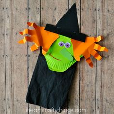 I'm super duper excited to share our latest <em class=short_underline>  paper bag craft </em> with you today. As you know, we've been having a lot of fun getting a head start on our Halloween crafting this past week. I've been thinking about all of our favorite Halloween books and two of our most favorite have a witch as a main character. It inspired us to make this adorable <b>  Paper Bag Halloween Witch Craft for Kids </b>. This o...