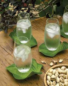 Leaf Coasters - Freshly cut large leaves make natural waterproof anchors for summer drinks. Lush foliage, such as the hosta leaves we used, add color to table settings and act as reminders of tropical vacations. Cut leaves early in the day, and set them in water immediately, keeping them hydrated in a container until it's time to serve drinks. Dry before using.