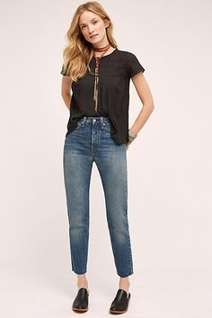 A timeless denim staple with a flattering high waist, straight leg, classic wash, and raw hem. From iconic denim brand Levi's.