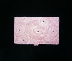 Adorable business card holder.. and inexpensive. Seller is great too!