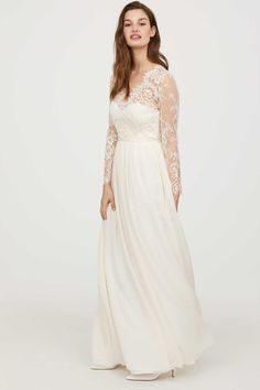 Cream. Long dress with bodice in lace and skirt in airy, woven fabric. Scalloped V-neck, boning in sides, and opening at back of neck with covered button.