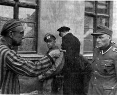 An immensely powerful photo showing a Concentration camp inmate confronting a camp guard.  The look on the guard's face shows not remorse, but the meekness of a bully brought to judgement.