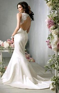 Backless Wedding Dress Gown - Go lacy and backless for a feminine look with this striking backless wedding gown.